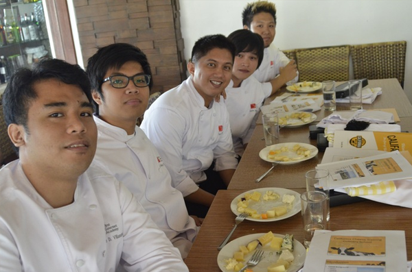 """Students of First Gourmet Academy with their cheese tasting activity"""